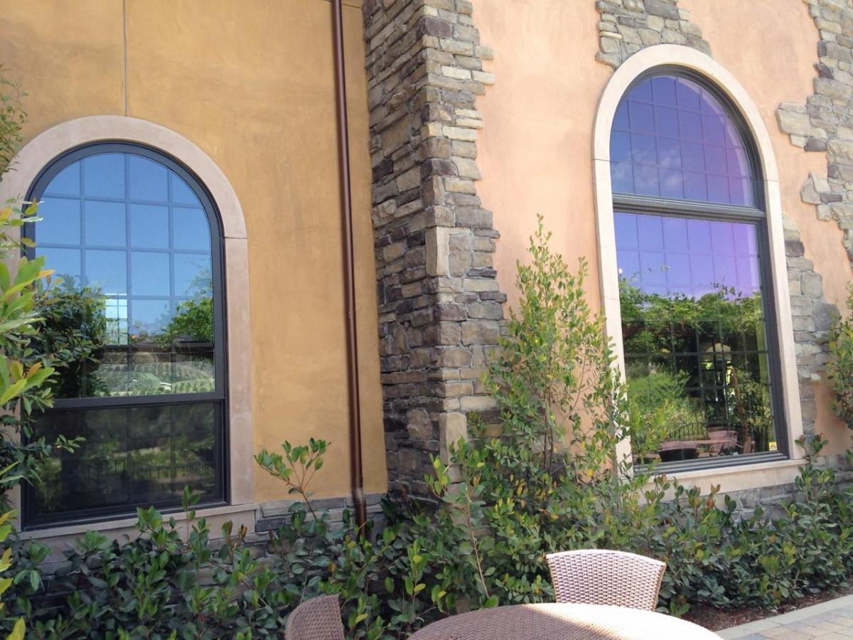 side of old winery with replacement windows