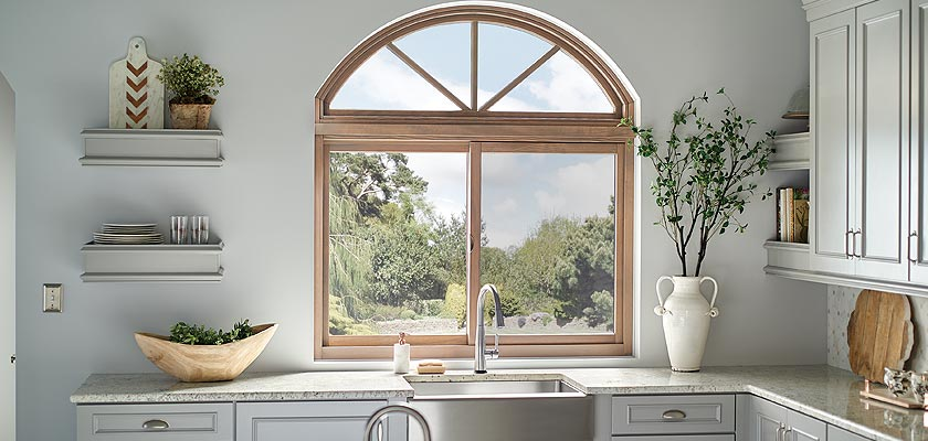 Essence Series wood radius over horizontal slider window