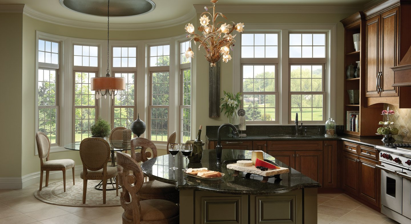 Tuscany Series vinyl single hung windows with grids in tan