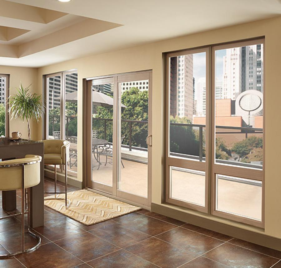 Montecito Series picture awning windows and sliding patio door in tan