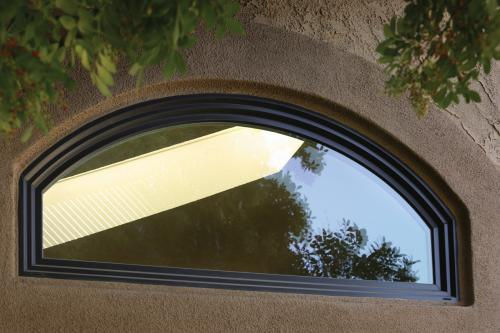 Tuscany Series arch picture window in Bronze