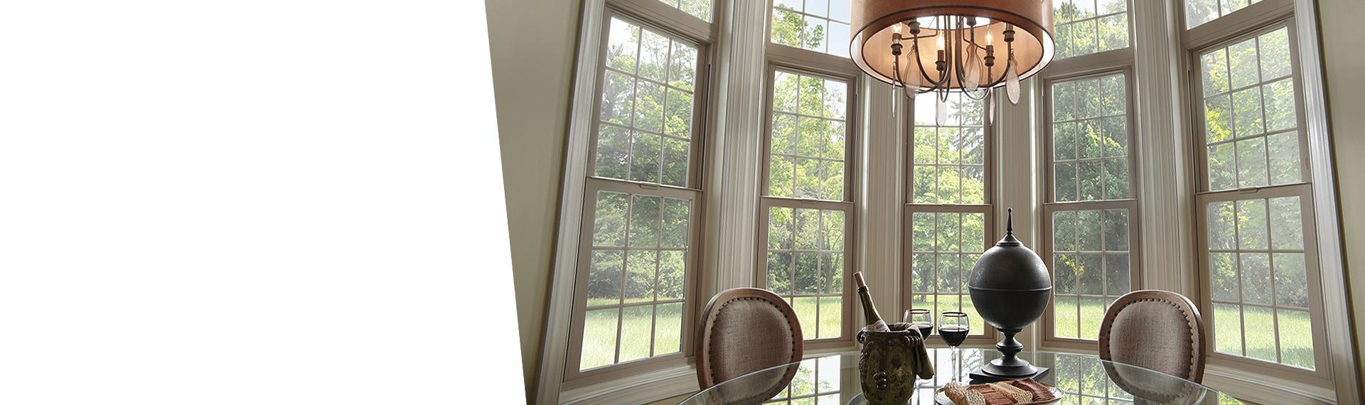 Tuscany Series vinyl double hung windows in tan