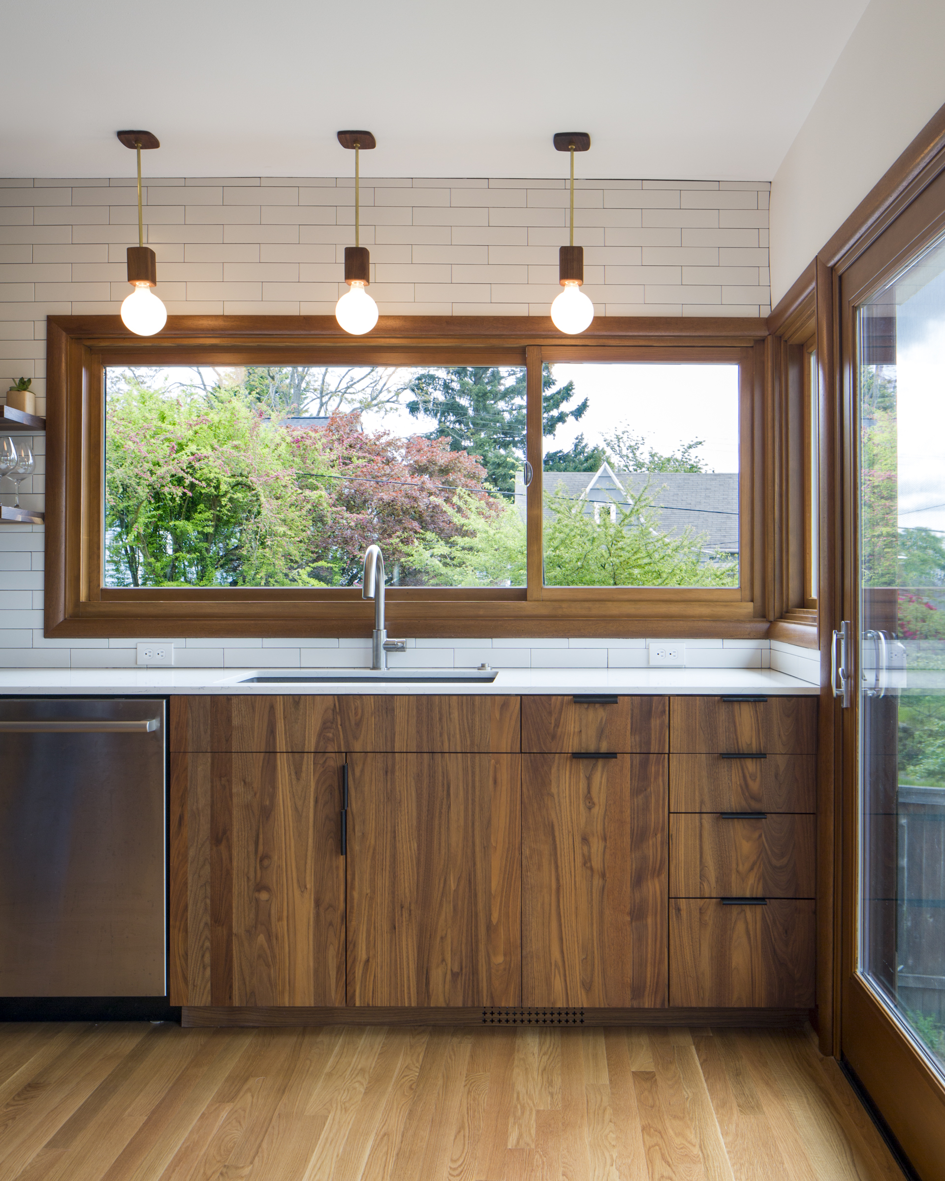 Wood windows over a sink in the kitchen home remodel