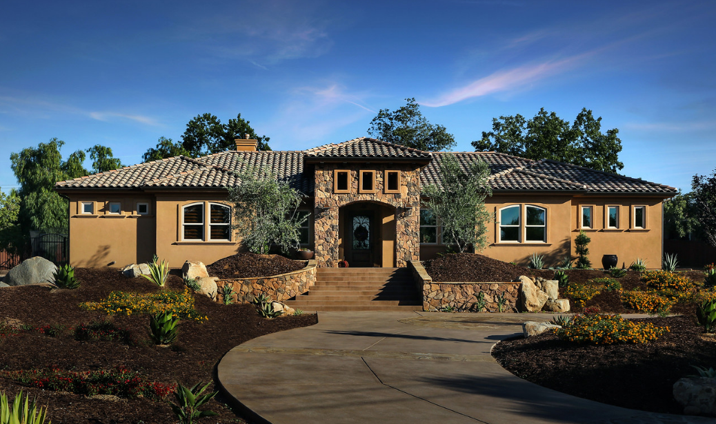 Traditional home with tan painted vinyl windows