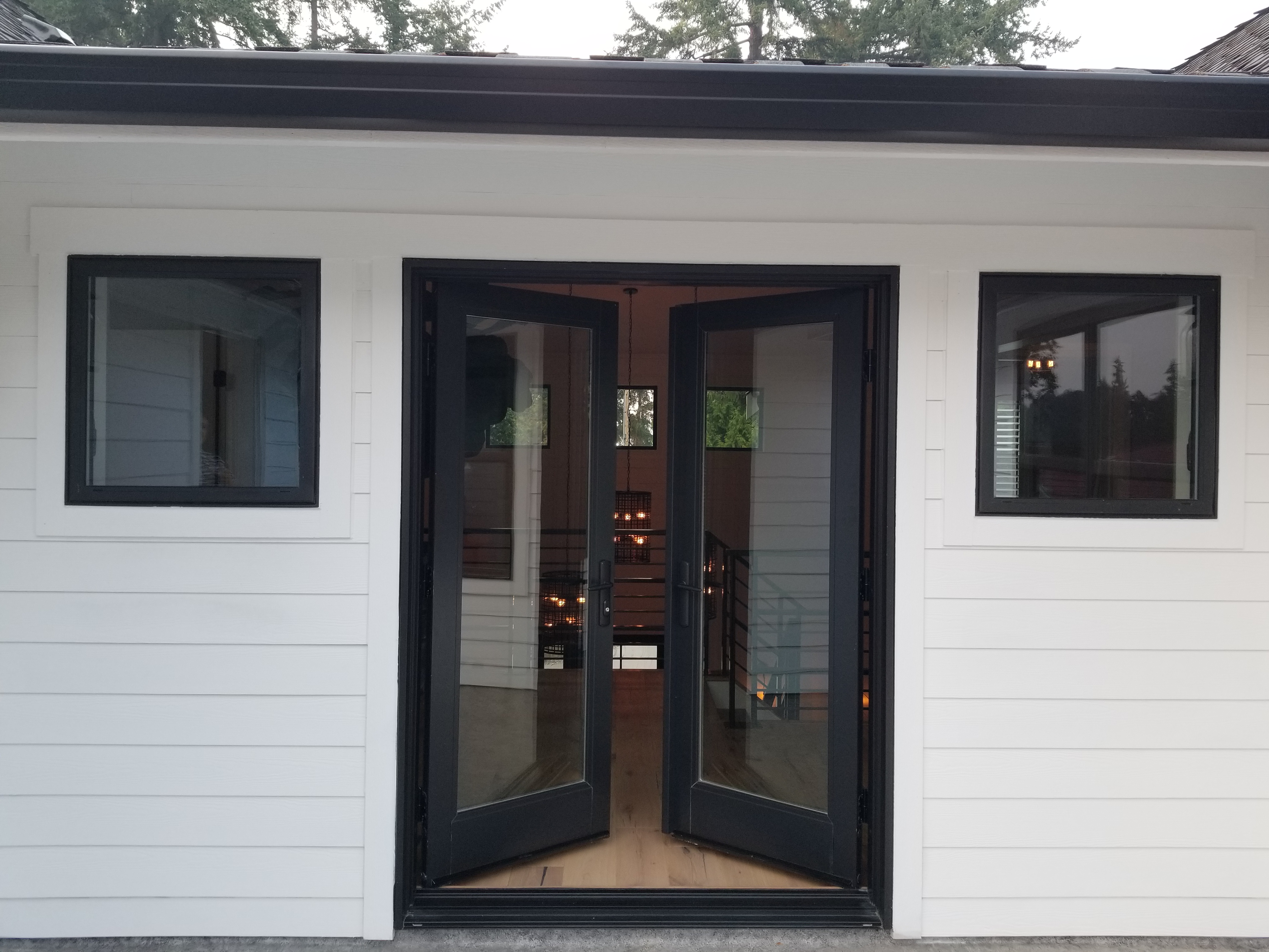Inswing fiberglass patio doors in the color Black Bean