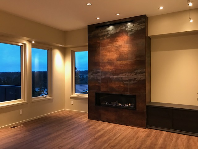 Modern fireplace alongside wood windows