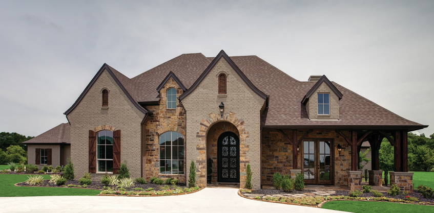 French country retreat features style line vinyl windows for Big one story homes