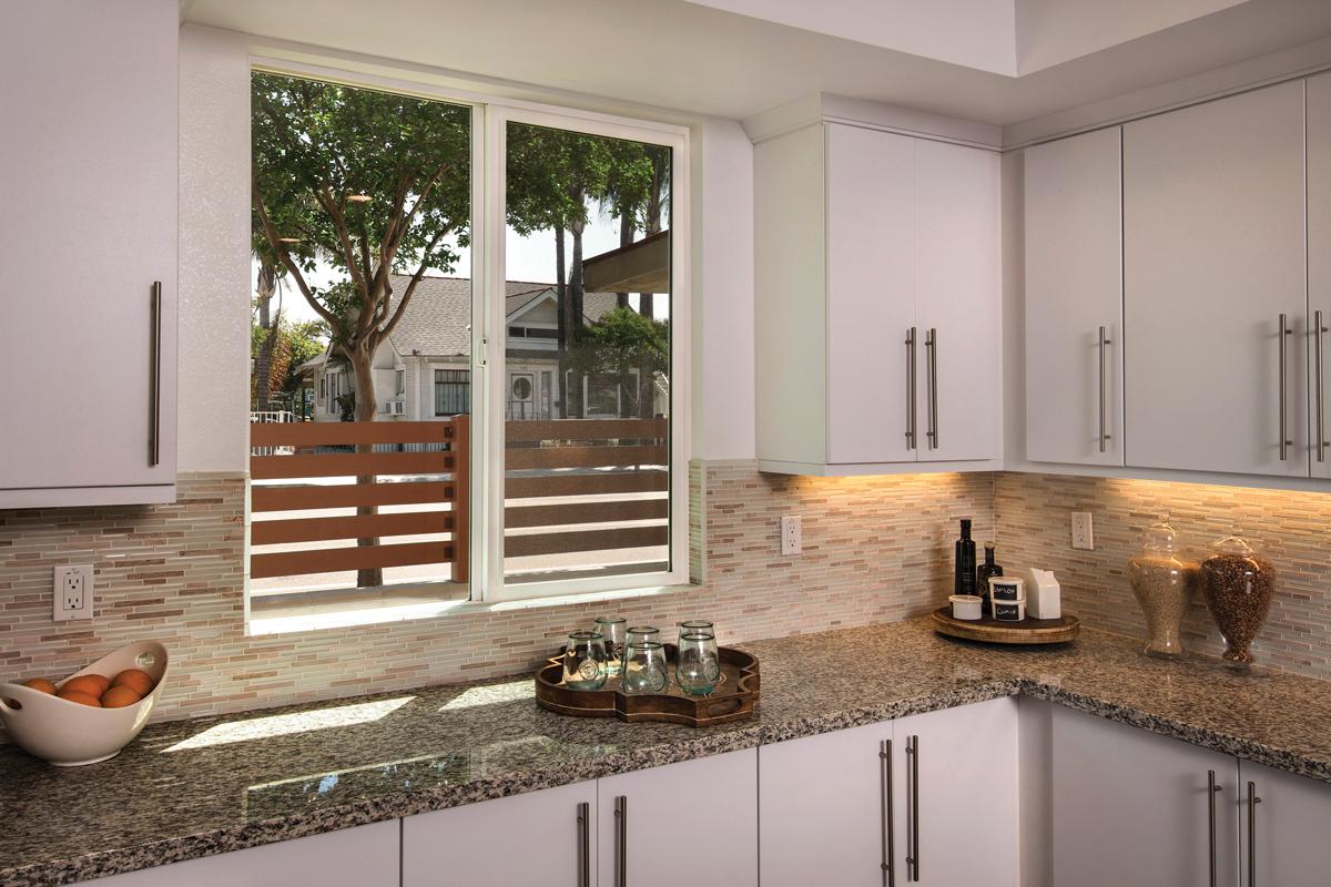 Vinyl windows help green home meet energy efficiency for Milgard energy efficient windows