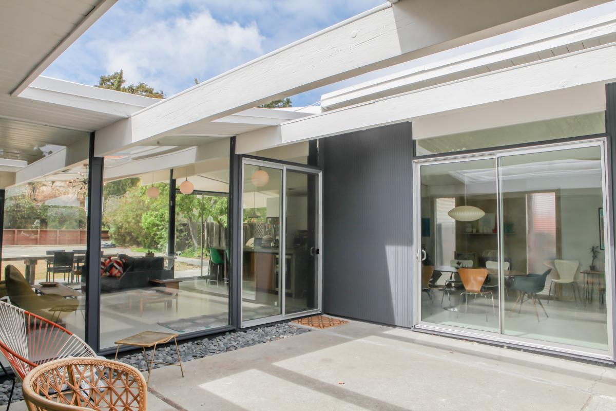 Glass Windows Fitted The Entire Back Of The Home To Look Out To The