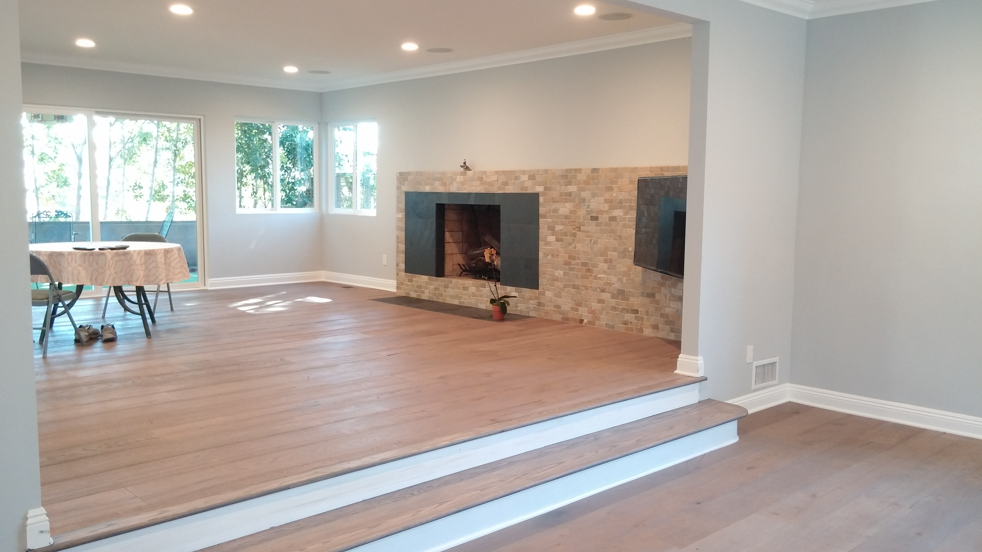 Fireplace with horizontal slider and bay window in front room