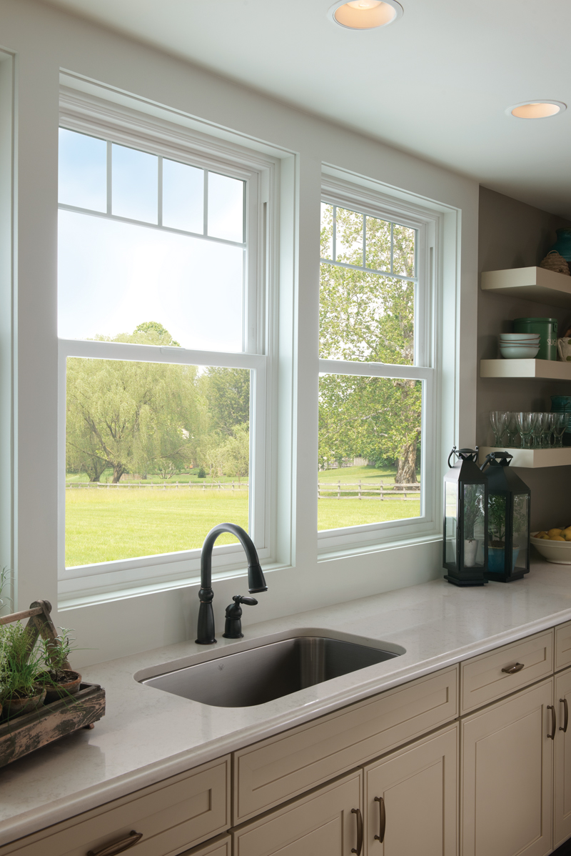Tuscany® Series white vinyl windows with valance grids.